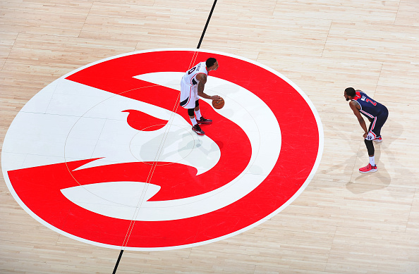 Jeff Teague of the Atlanta Hawks looks to drive against John Wall of the Washington Wizards on February 4, 2015 at Philips Arena in Atlanta, Georgia. (Photo by Scott Cunningham/NBAE via Getty Images)