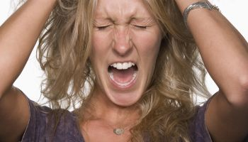 Woman pulling her hair and screaming