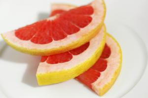 Close-up of slices of grapefruit in plate