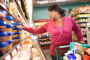 Black woman shopping in grocery store