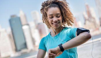 Sportive woman tracking her workout progress