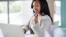 Black woman sitting at desk