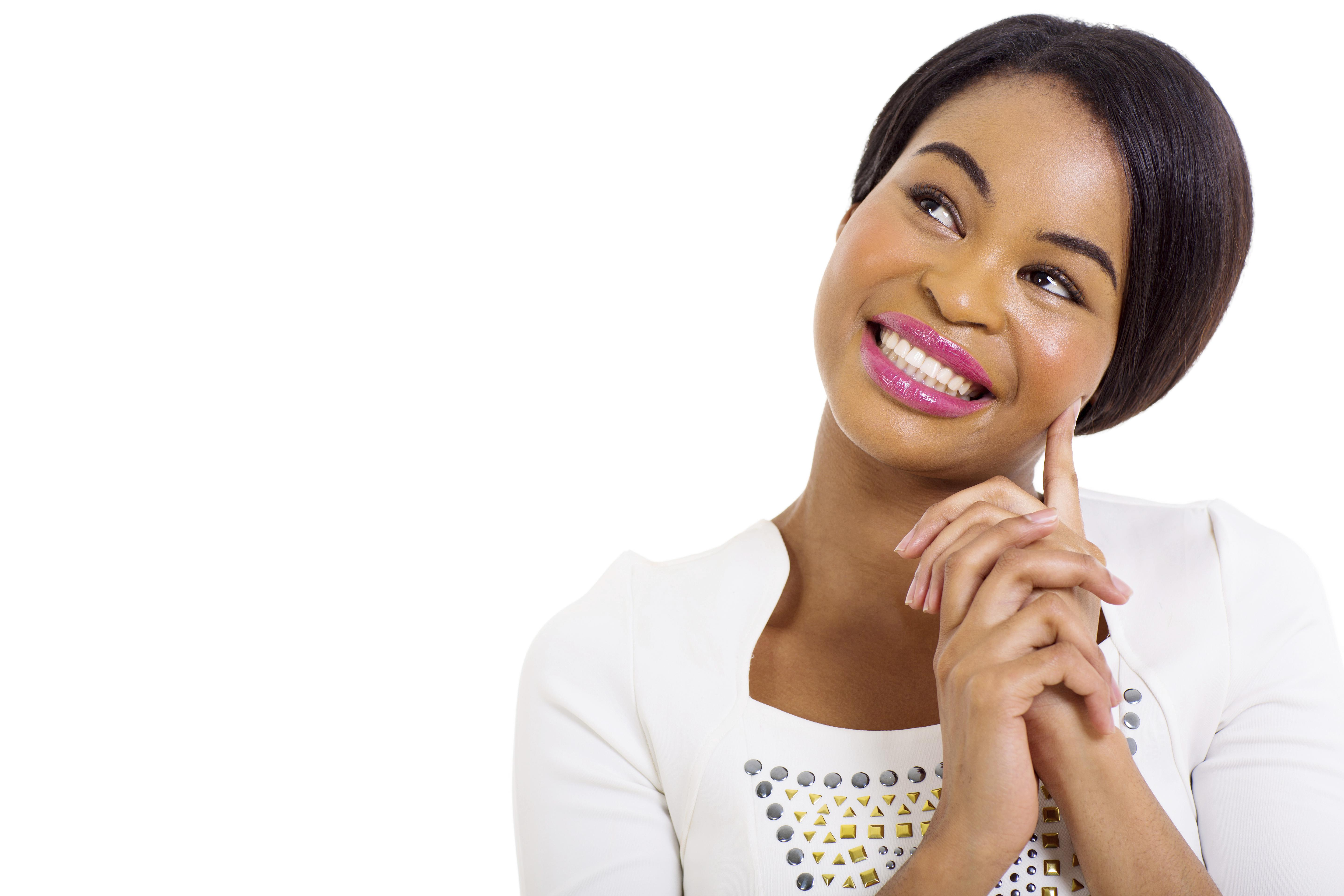thoughtful african american woman smiling on white background