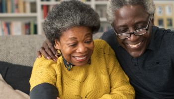 Senior couple checking blood pressure