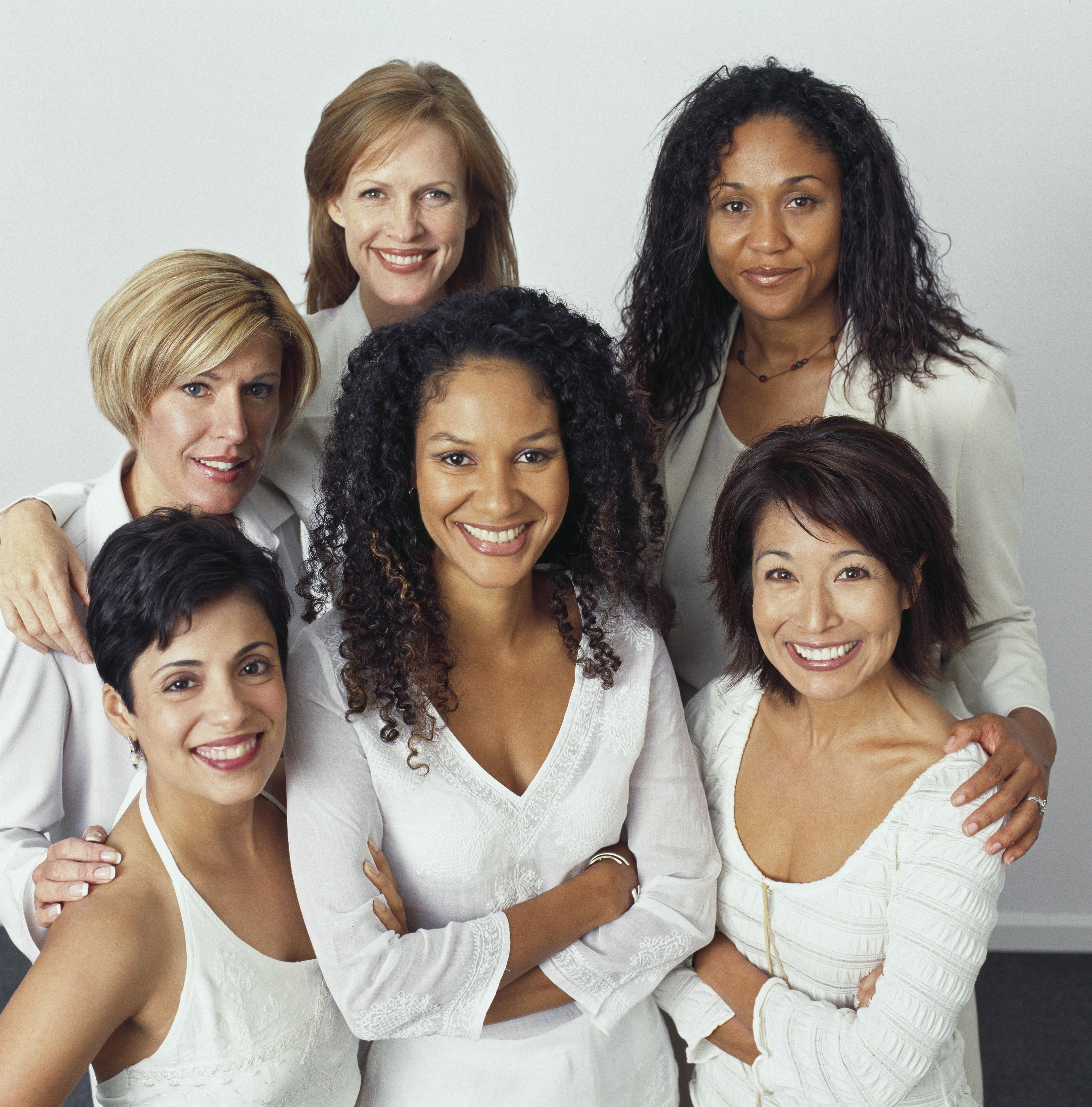 Smiling businesswomen dressed in white