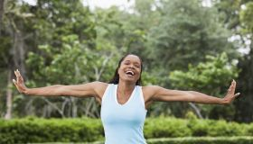 African American woman exercising in park